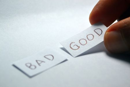 """good"" and ""bad"" written on paper"